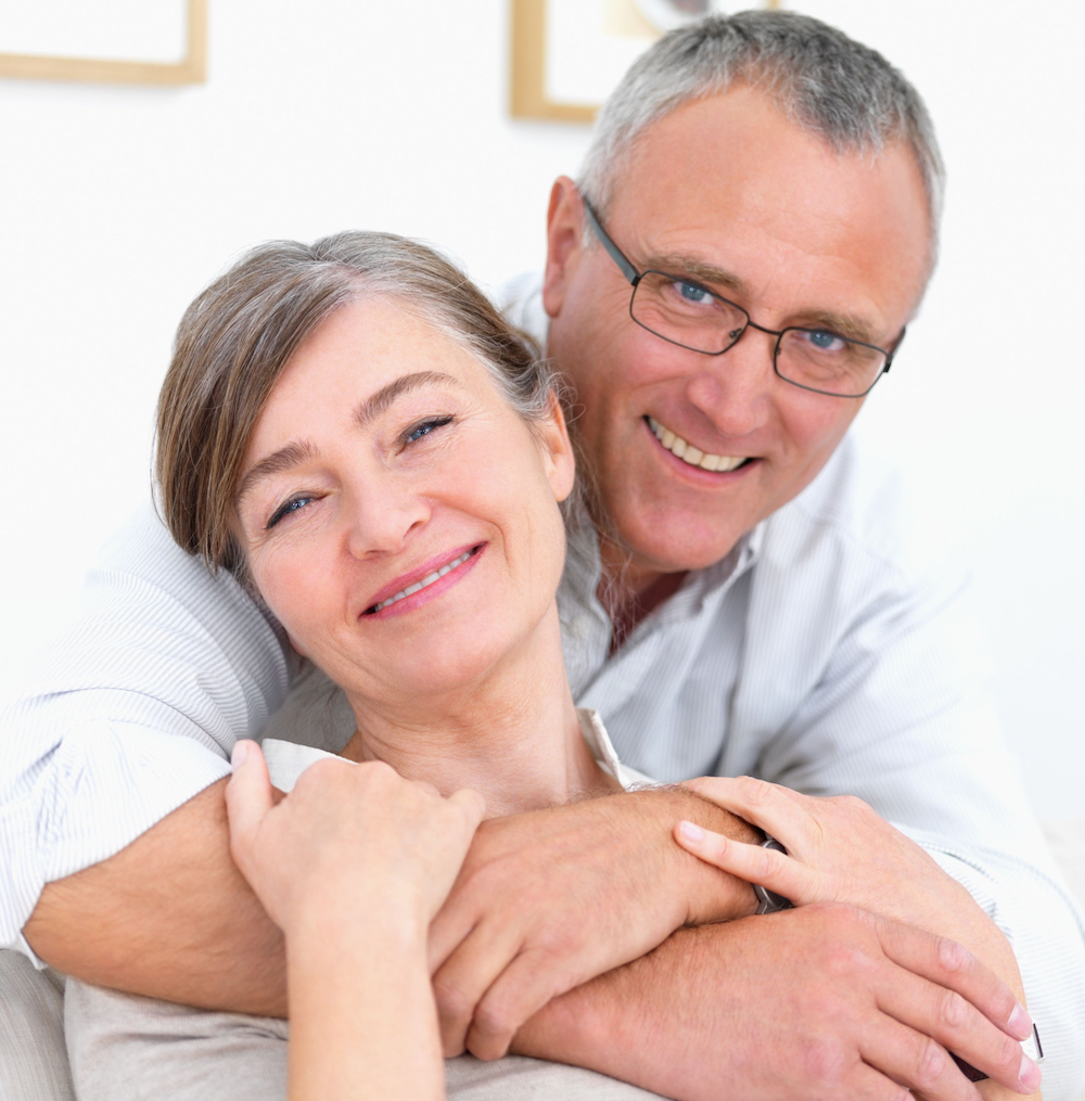 Closeup portrait of a smiling old couple at home